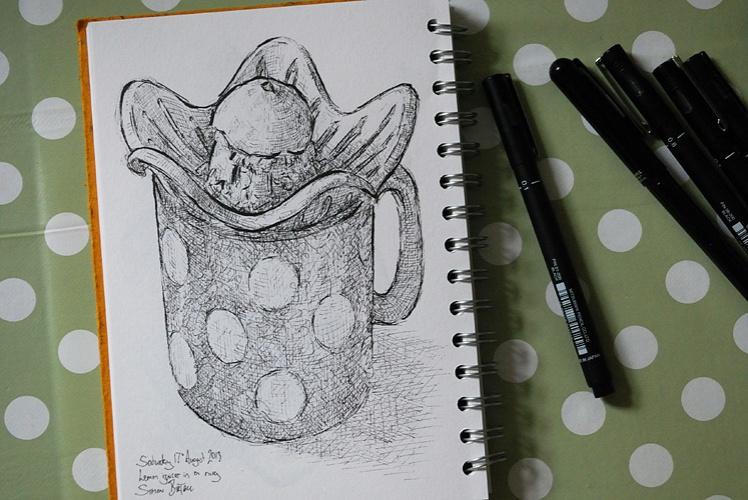 Drawing of a lemon juicer in a mug