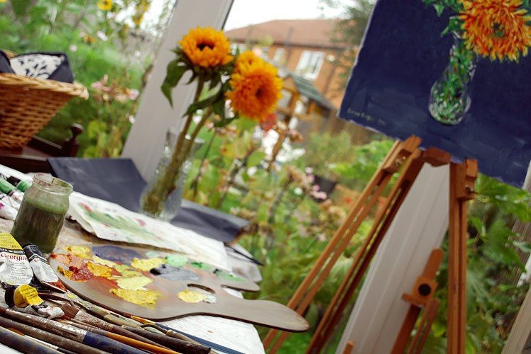 Painting sunflowers in a vase
