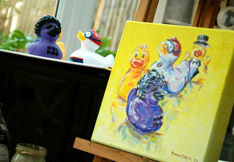 Painting four rubber ducks
