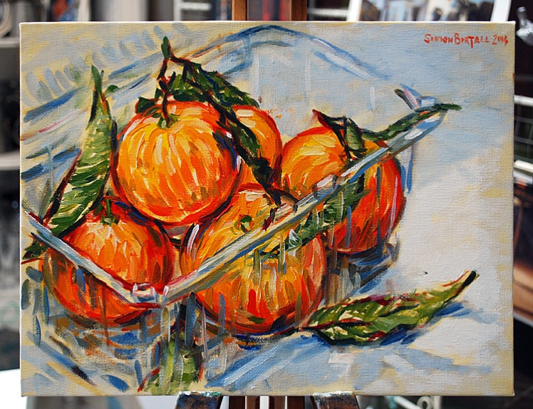 Painting of some clementines in a punnet