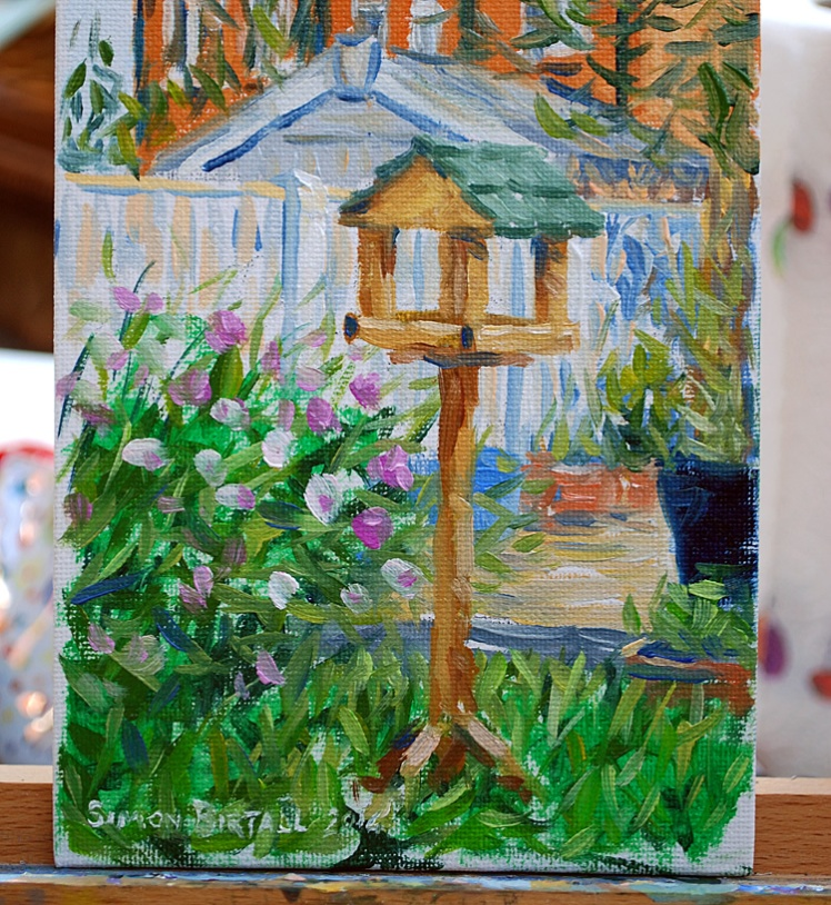 Painting of a bird table in a garden