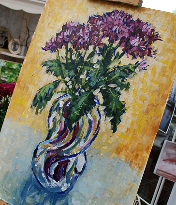 Painting of chrysanthemums in a glass vase